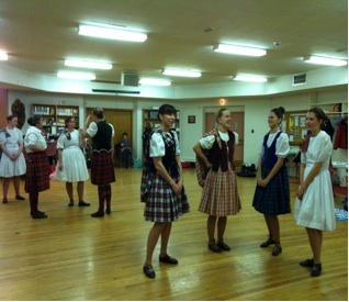 Dancers waiting for highland dance exam results.